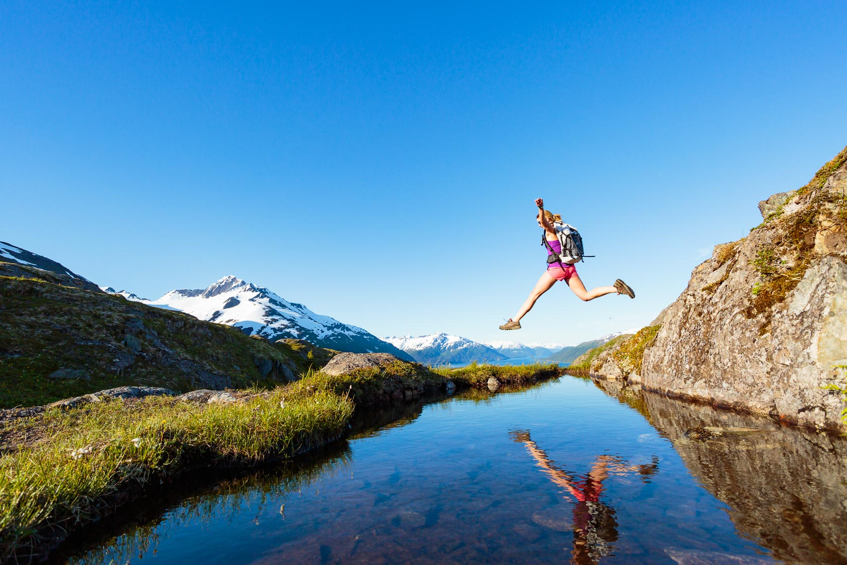 Woman Leaping Alaska Day Hike | Michael DeYoung