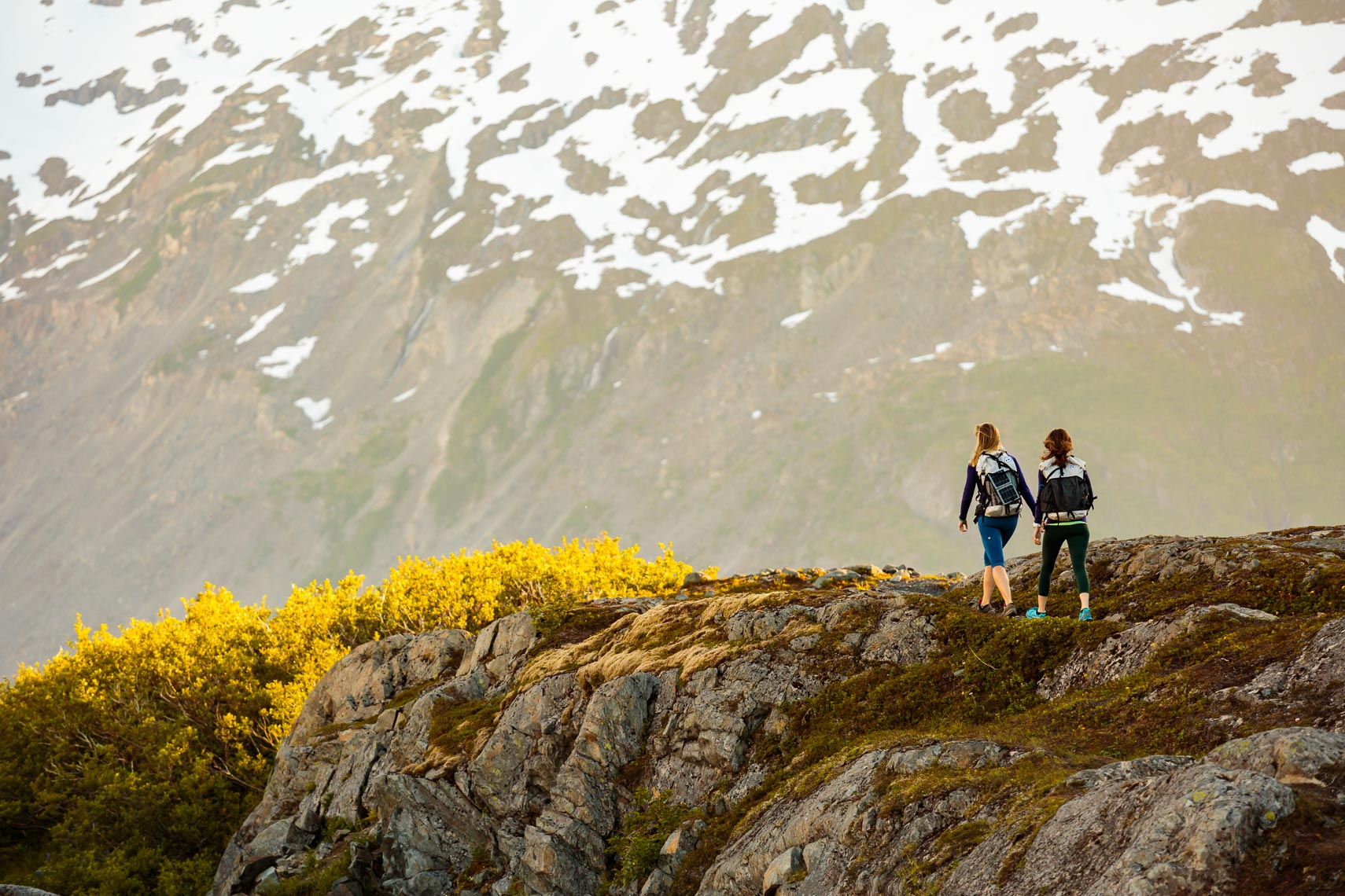 Female Hikers on Ridge Alaska | Michael DeYoung