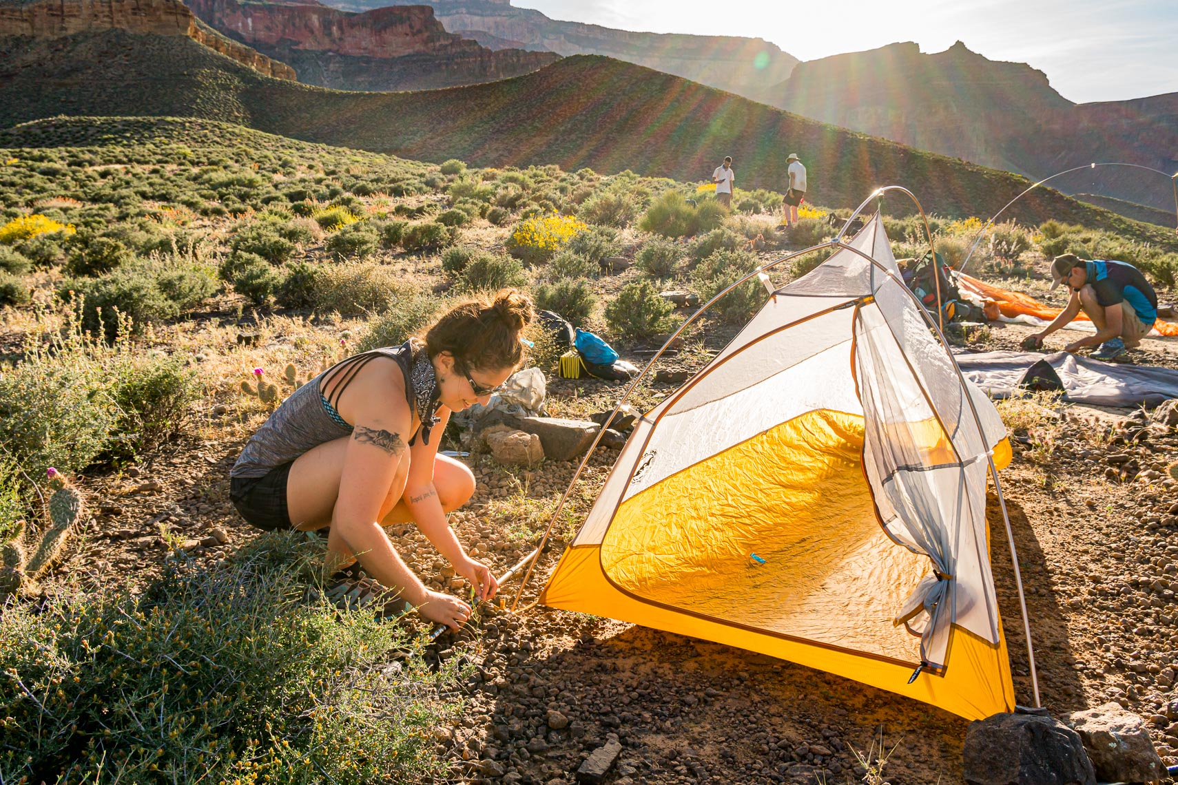 Female Ultralight Backpacker At Camp | Michael DeYoung