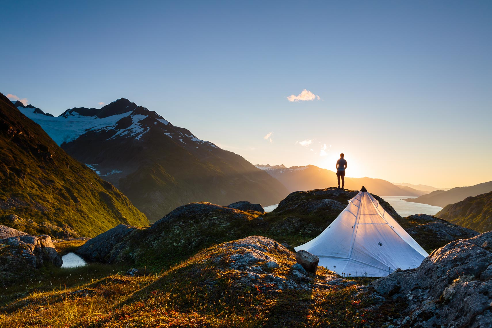 Alaska Travel Hiker At Remote Camp | Michael DeYoung