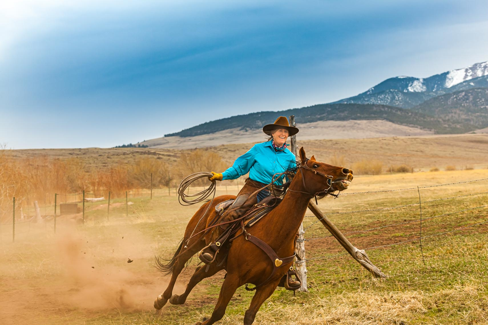 Western Cowgirl Riding Horse in Colorado | Michael DeYoung