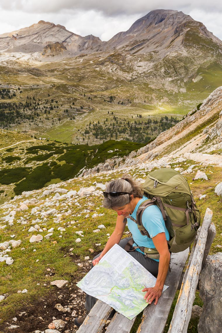 Hiker on Bench Dolomites Trail | Michael DeYoung