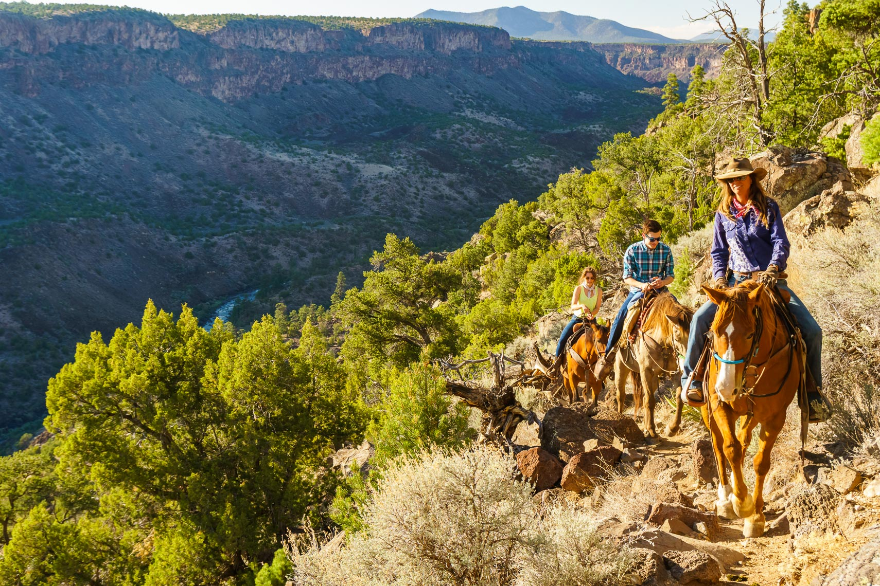 Couple On Guided Horseback Ride Visit Taos | Michael DeYoung