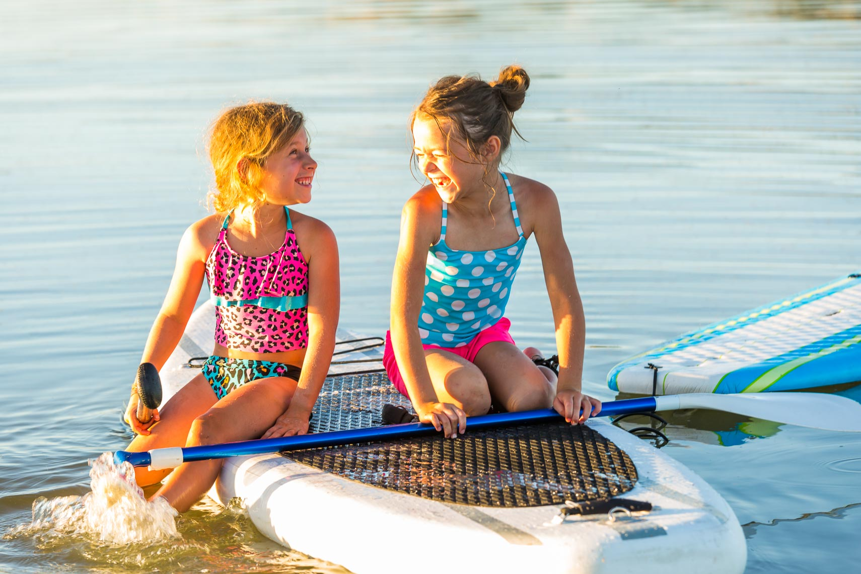 Girls Share Paddle Board Great Salt Lake | Michael DeYoung
