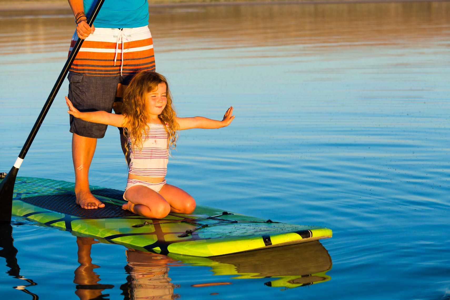Young Girl on Paddle Board | Photographer Michael DeYoung